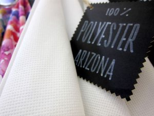 Linen-like polyester fabric for digital printing.